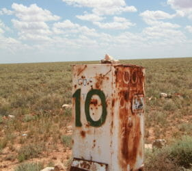 Rusty box road marker on Cook Road, 10Km to Cook