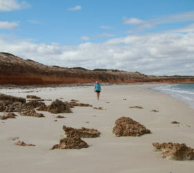 Leonie walking on the beach at the Bamboos